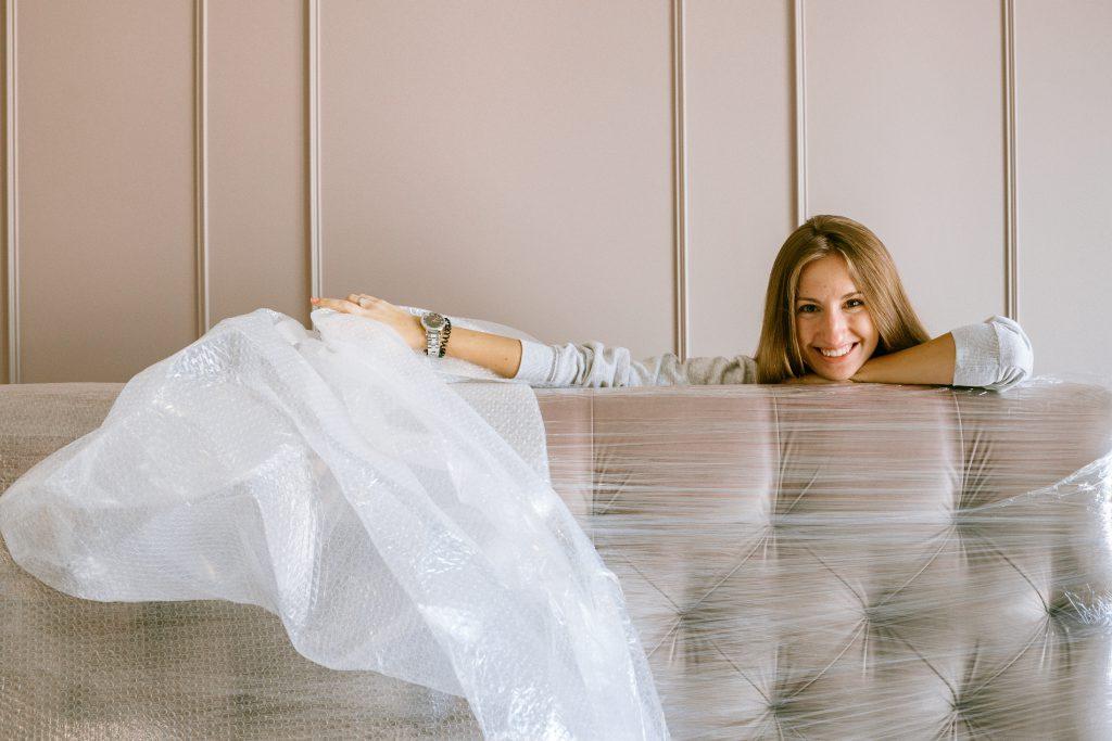 woman unwrapping mattress